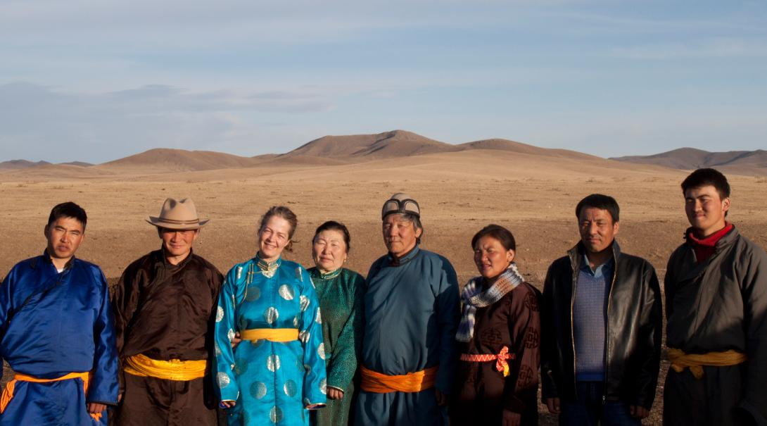 A volunteer takes a group photo with her host family in Mongolia during her cultural exchange program.